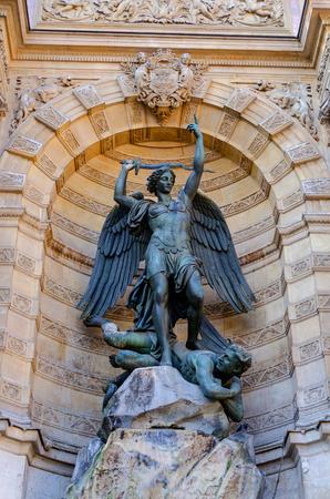 Detail of saint michel fountain in Paris, France