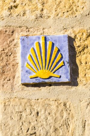 camino: Ceramic tile with a shell that indicates the direction of camino de santiago