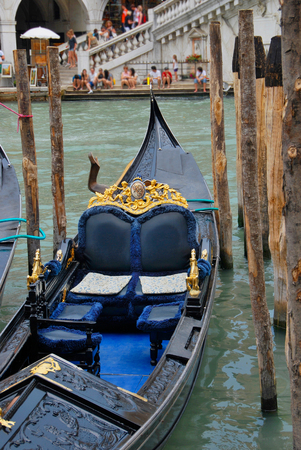 grand canal: typical venetian gondola moored in grand canal. Venice, Italy