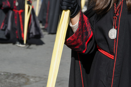 semana santa: Detail of the black robe of a participant in the Palms sunday procession. Semana Santa in Valladolid. Spain