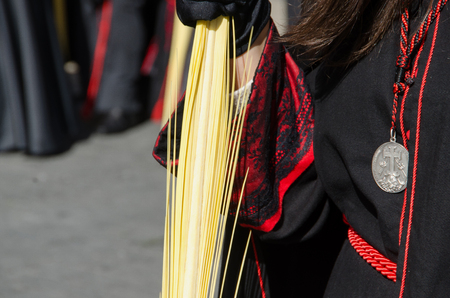 devote: Detail of the robe of a participant in the Palms sunday procession. Semana Santa in Valladolid. Spain