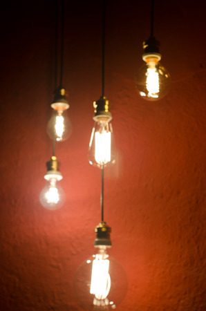 incandescent: Vintage style incandescent bulbs. Blurred background