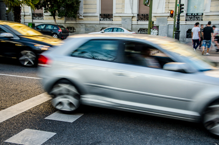 urban scene: Urban scene with cars in motion. City traffic