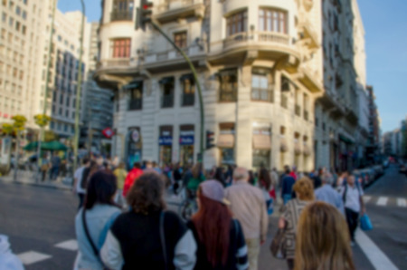 busy street: Blurred picture of people in a crosswalk. Urban scene in Madrid Stock Photo
