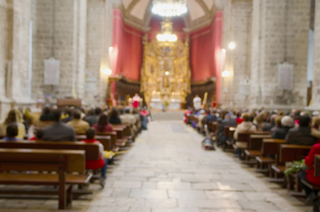 Blurred picture of a mass in a catholic cathedral. Christian ceremony of the sacred mass
