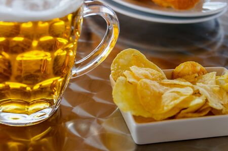 pint: Cold pint of beer with fried potatoes