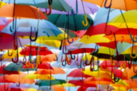 umbrella rain: Blurred background made wiht a  lot of multicolored umbrellas.