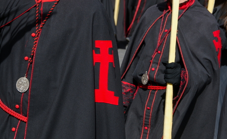 devote: Detail of the black robe of a participant in the Palms sunday procession. Semana Santa in Valladolid. Spain