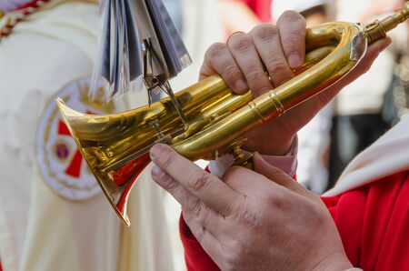 cornet: A musician plays a cornet in a sacred week, procession