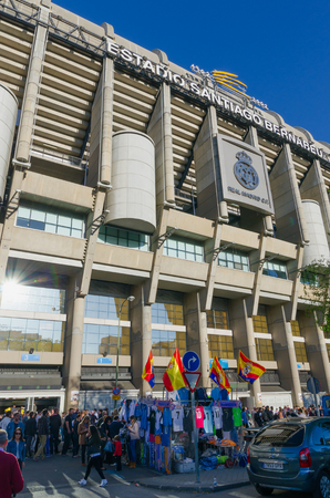 castellana: MADRID, SPAIN - APRIL 18: Facade of the Santiago Bernabeu Stadium on April 18, 2015 in Madrid, Spain. Real Madrid supporters are buying merchandising near the stadium before the match starts