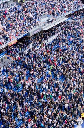 castellana: MADRID, SPAIN - APRIL 18: Santiago Bernabeu Stadium spectators standing before the match on April 18, 2015 in Madrid, Spain. Santiago Bernabeu Stadium is the headquarters of Real Madrid C.F. Editorial
