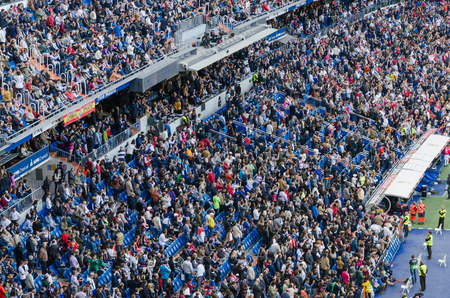 castellana: MADRID, SPAIN - APRIL 18: Santiago Bernabeu Stadium spectators before the match on April 18, 2015 in Madrid, Spain. Santiago Bernabeu Stadium is the headquarters of Real Madrid C.F. Editorial