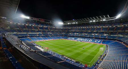 castellana: MADRID, SPAIN - APRIL 29: Night view of Santiago Bernabeu stadium on April 29, 2015 in Madrid, Spain. Real Madrid C.F. was born in the year 1902 and Santiago Bernabeu Stadium is its headquarters Editorial