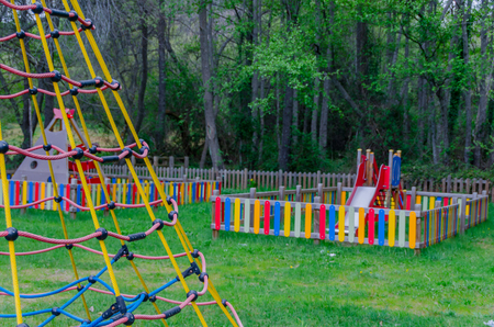 child's: Playground in a park. Childs equipment for fun and amusement