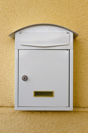 Old style white metallic mailbox. Messaging and communications concept