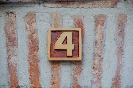 number four: 4. Number four made of brown clay