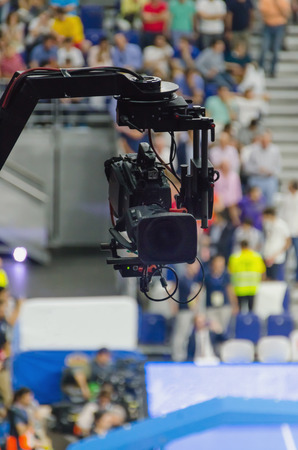 live action: Tv camera hanging on a tv crane. Professional equipment for broadcasting