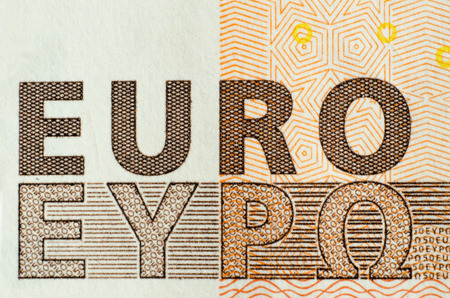 banknote: Euro word. International and greek symbols in an 50 Euro banknote. Grexit.