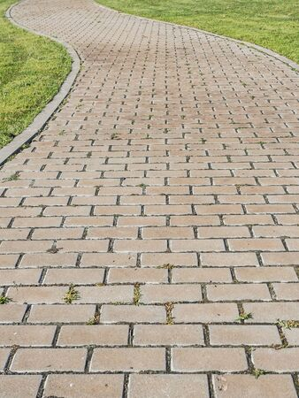 cobbles: Curvy urban path in a park made with cobbles