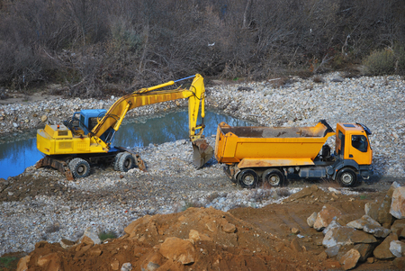 public works: Heavy machinery for construction and public works. Excavator and truck