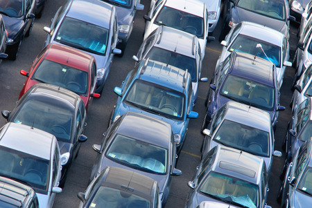 Many cars are parked in rows Stock Photo