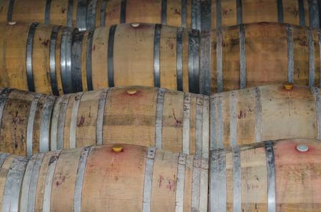 recipient: Winery. Wooden wine barrels in the cellar. Wine recipient Stock Photo