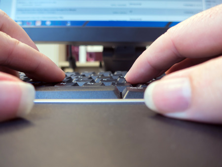 subjective: Subjective view of two wands pressing keys in the keyboard