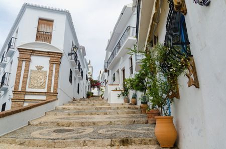 frigiliana: Typical street in the village of frigiliana, Malaga, Andalusia, Spain. Andalusian architecture Stock Photo