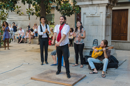 percussionist: GRANADA, SPAIN - SEPTEMBER 9: A group of flamenco performers in the streets of Granada on September 9, 2015 in Granada, Spain. Flamenco is the most popular music in Spain.