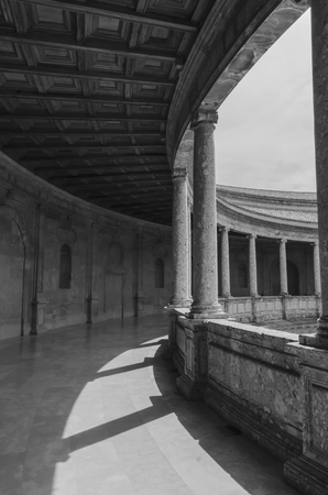 v shape: Columns in the courtyard of Charles V palace. Alhambra. Granada. Spain Editorial