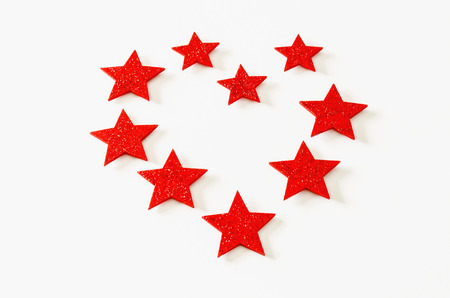 star shaped: A valentines heart made with some glitter red stars. Love background Stock Photo
