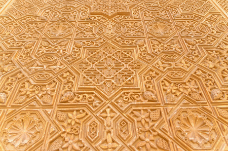 andalusia: Detail of Muslim decoration in a wall in Alhambra of Granada, Andalusia, Spain