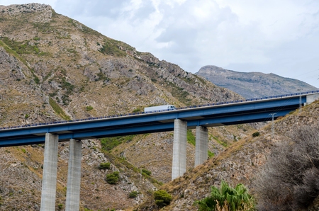 passing over: A truck is passing over a viaduct. Traffic and transport Stock Photo