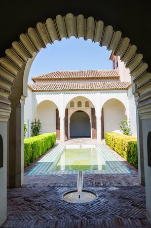 alcazaba: Courtyard garden of the Cuartos de Granada in the Alcazaba of Malaga. Andalusia, Spain