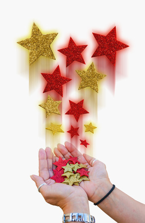 brigh: two hands holding a bunch of magical stars. Magic, illusion, imagination and christmas concepts Stock Photo