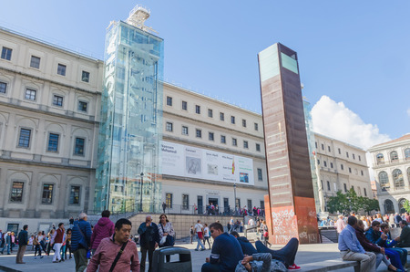 sofia: MADRID, SPAIN - OCTOBER 12, 2015: Tourists awaiting to enter in centro de arte reina Sofia, Madrid, Spain. Reina Sofia national museum is one of the most famous art centers in the city of Madrid