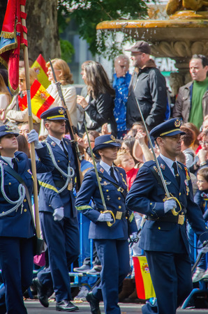 military: MADRID, SPAIN - OCTOBER 12, 2015: Spanish Air troops marching in a military parade. In October, 12 Spain celebrates the Spanish National Day Editorial