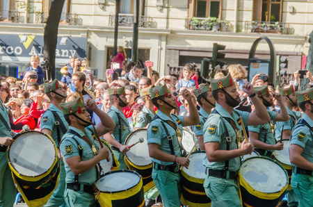 parades: MADRID, SPAIN - OCTOBER 12, 2015: Spanish legionnaries military band marching and playing drums in the military parade of the Spanish National Day