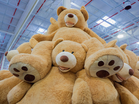 A mountain of giant teddy bears Stock Photo