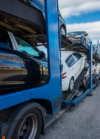 car carrier: Some new cars in a car carrier truck