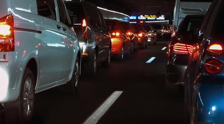night traffic: traffic jam in an urban tunnel. Lot of cars in a row