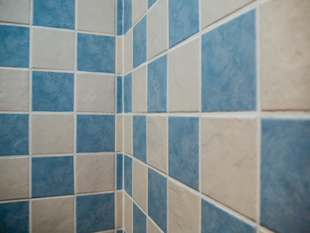 building wall: Decorative tiles in white and blue. Bathroom geometric design