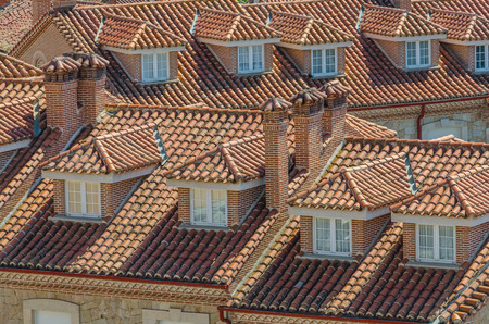attics: View on tile roofs with brick pipes