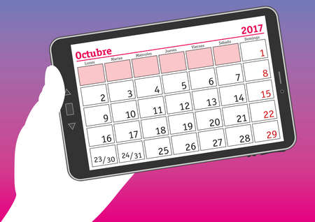 tablet pc in hand: october 2017, octubre 2017. A hand holds a tablet pc with a calendar sheet in spanish.