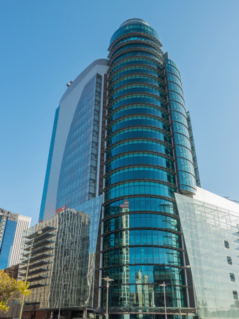 building a chain: MADRID, SPAIN - OCTOBER 10, 2015: Modern glass building owned by the English Court, was built after the fire that destroyed the previous building. El Corte Inglés is Spains only remaining department store chain