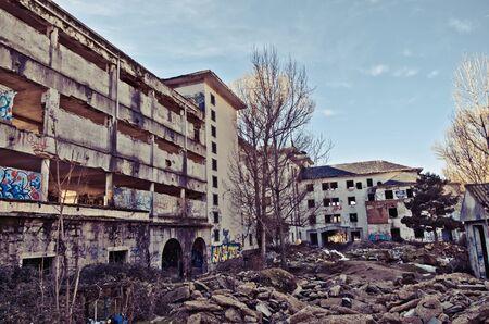 decaying: Decaying buildings at daytime. Uninhabitable urban ruins