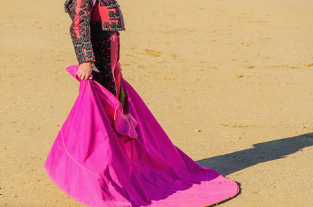 corrida: A bullfighter awaiting for the bull in the bullring. Corrida de toros