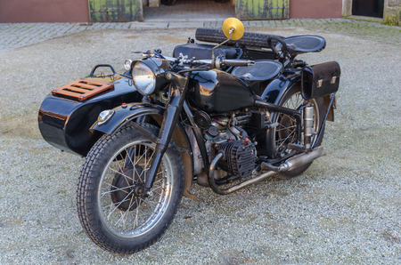 sidecar: Old motorbike with sidecar in black. Retro style transportation