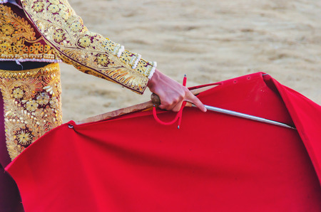 corrida: A bullfighter awaiting for the bull with his cape and sword. Corrida de toros Stock Photo