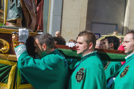 christianity palm sunday: VALLADOLID, SPAIN - MARCH 29, 2015: Cofrades, members of a brotherhood are carrying sacred imaginery in Valladolid, Spain. The city of Valladolid has some of the most famous processions in the spanish semana santa